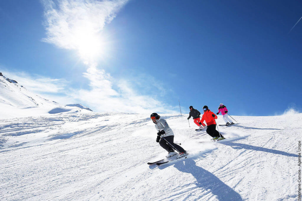 Group of skiers staying safe on the slopes in Val d'Isère